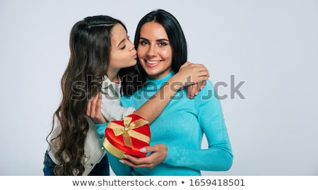 Stock photo: daughter kissing mother and giving her present