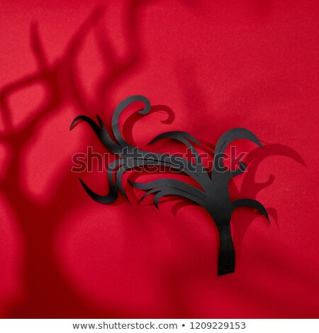 Pattern of shadows and handmade paper black branch on a red background with space for text. Hallowee Stock photo © artjazz