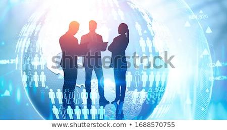 Zakenman zakenvrouw planeet hologram business toekomst Stockfoto © dolgachov