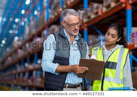 businessman showing warehouse to worker Stock photo © dolgachov
