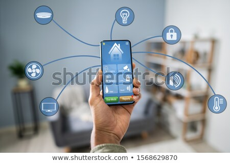 persoon · temperatuur · thermostaat · mobieltje · hand - stockfoto © andreypopov