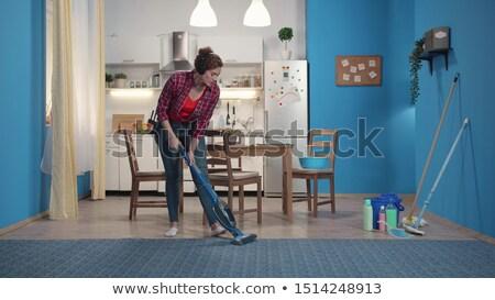 Donna aspirapolvere cuffie home famiglia lavori di casa Foto d'archivio © dolgachov