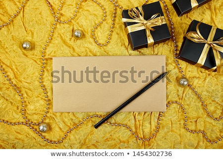 black gift boxes with gold ribbon and blank sheet paper stock photo © illia