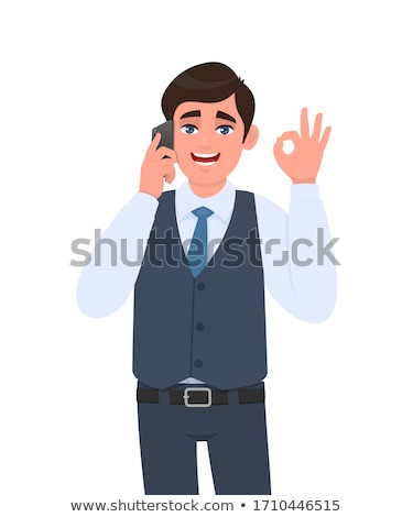 young man speaking on the phone and making ok sign Stock photo © feedough