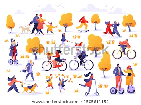 people walking dog in autumn park man on scooter stock photo © robuart