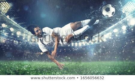 Futebol bola acrobático chutá ar estádio Foto stock © alphaspirit