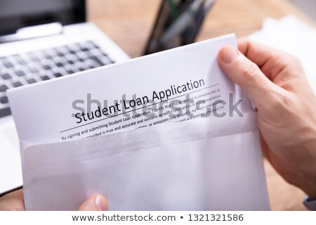 Person Removing Student Loan Application Form From Envelope Stock photo © AndreyPopov