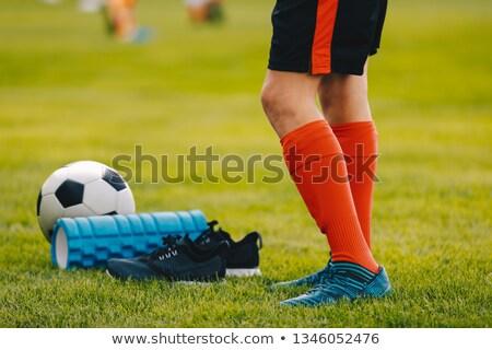 ног · футболист · мальчика · сапогах · мяча · пена - Сток-фото © matimix