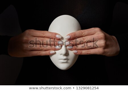 Girl's hands close eyes of plaster mask face on a black background. See no evil. Concept three wise  Stock photo © artjazz