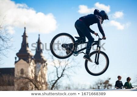 Lezser kerékpáros lovaglás bicikli gyors hipszter Stock fotó © ra2studio