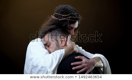 crown of thorns on the hand of a man stock photo © nito