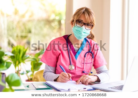 doctors looking at camera while sitting on medical office stock photo © andreypopov