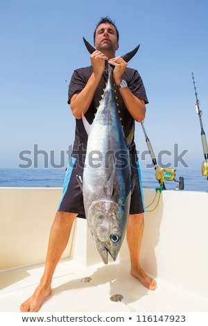 Fisherman catches tuna from yacht Stock photo © jossdiim