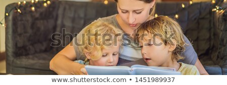 Teacher, tutor for home schooling Boy and girl at the table. Or mother, daughter and son. Homeschool Stock photo © galitskaya