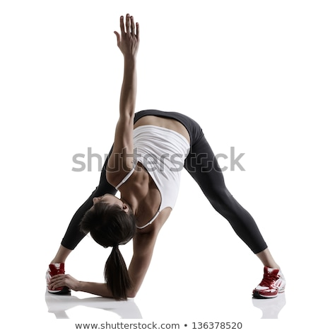 Fitness woman stretching full body over white background. Stock photo © Lopolo