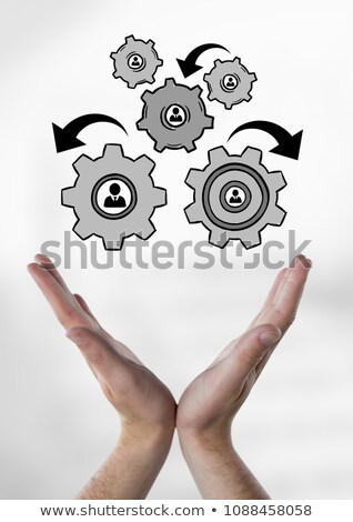 Hand interacting with people in cogs graphics against office background Stock photo © wavebreak_media