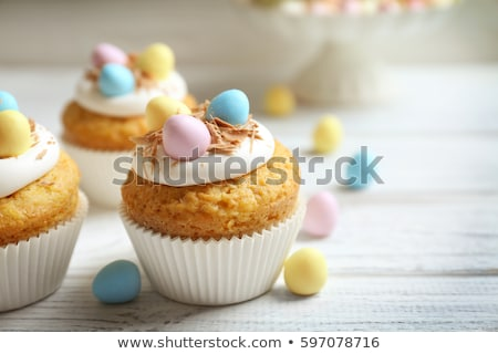 cupcakes with easter eggs and candies on table Stock photo © dolgachov