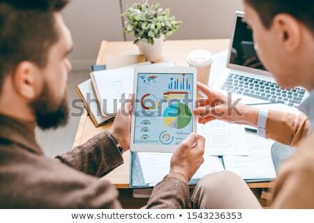 Dwa touchpad finansowych wykresy Zdjęcia stock © pressmaster