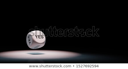 Yes Text Dice Spotlighted on Black Background Stock photo © make