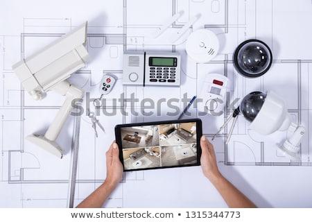 Személy tart digitális tabletta cctv kamera Stock fotó © AndreyPopov