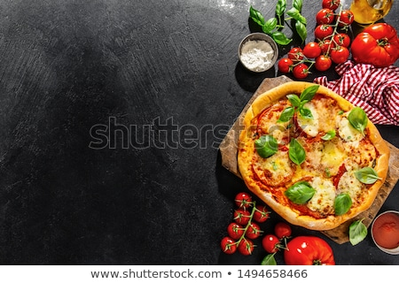 Delicious italian pizza served on black wooden table Stock photo © dash