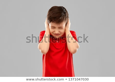 stressed boy in red t-shirt closing ears by hands Stock photo © dolgachov