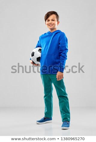smiling boy in blue hoodie with soccer ball Stock photo © dolgachov