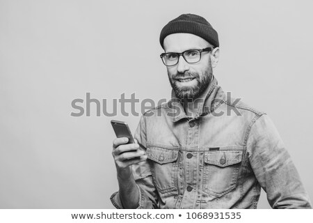 Attractive middle aged male model with bristle dressed in fashio Stock photo © vkstudio