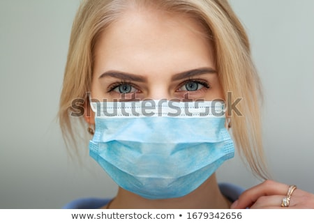 Beauty young woman wearing respiratory protective medical mask Stock photo © ia_64