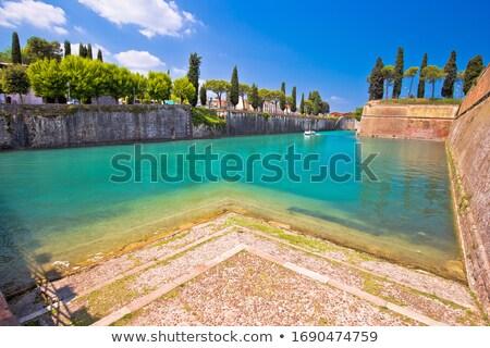 Peschiera del Garda turquoise channel around town walls view, Stock photo © xbrchx