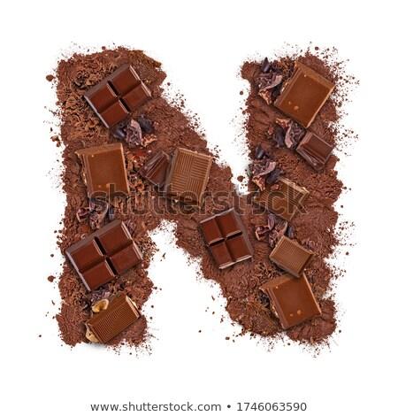 N betű csokoládé szelet darabok izolált fehér étel Stock fotó © grafvision