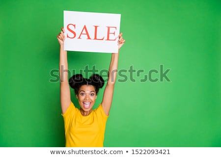 Image of young multinational women smiling and holding placards Stock photo © deandrobot
