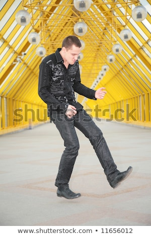 guy jump and allegorize play on  guitar on footbridge Stock photo © Paha_L