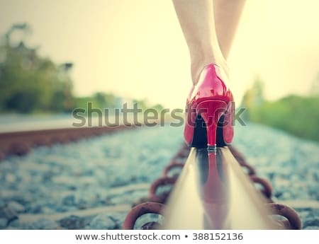 Womens legs in red high heel shoes stock photo © Richard Thomas ...