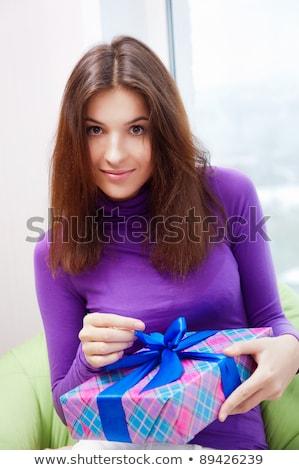 Encantado mulher abertura dom sessão saco de feijão Foto stock © HASLOO