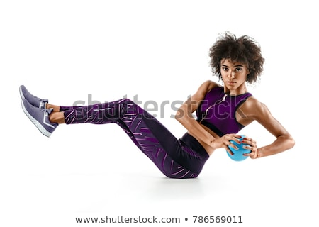 Young woman working out with a ball isolated on a white backgrou stock photo © HASLOO