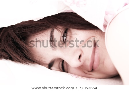 closeup portrait of young pretty woman lying in her bed at morni stock photo © hasloo