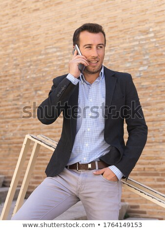 Businessman leaning against railing Stock photo © photography33