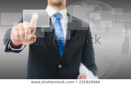 Businessman with Touch screen mobile phone and virtual buttons Stock photo © vlad_star