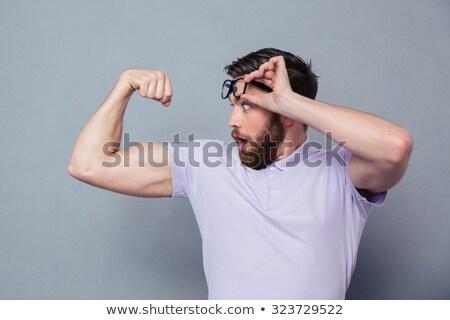 portrait of confident muscular man flexing his biceps stock photo © dash