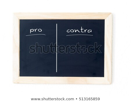 Pros and cons list drawn with chalk on a blackboard Stock photo © bbbar