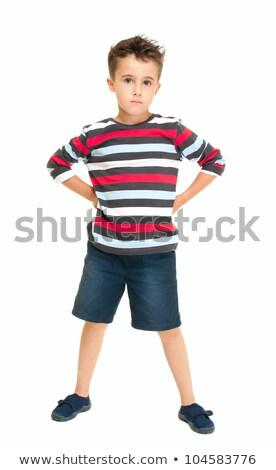 Single naughty little boy standing stock photo © pekour