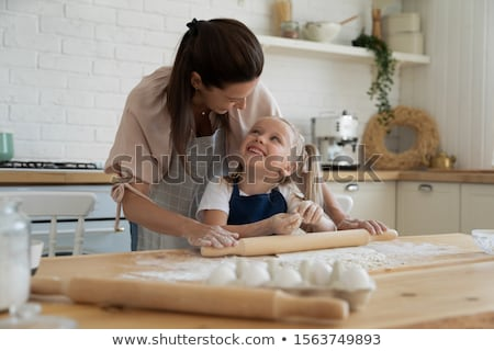 Woman rolling dough using rolling pin Stock photo © brebca