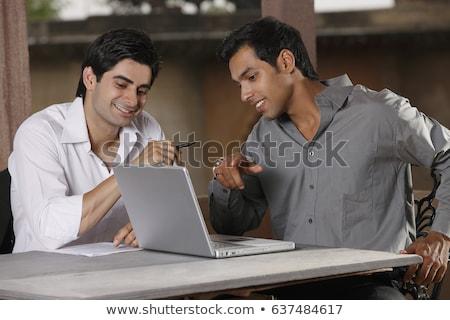 Dois indiano homem discussão homem bonito falante Foto stock © ziprashantzi