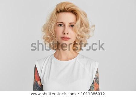 Serious tattoo girl Stock photo © sumners