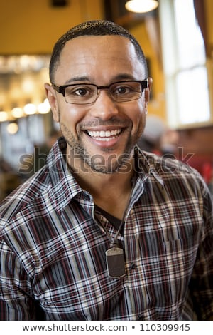 portrait of young black man in coffee shop stock photo © schmedia