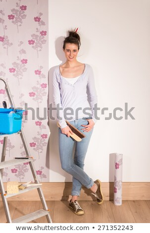 Woman wallpapering her room Stock photo © photography33