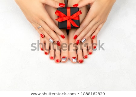 Female feet with nail varnish stock photo © stryjek