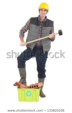 manual worker stood by crate of recyclable building materials stock photo © photography33