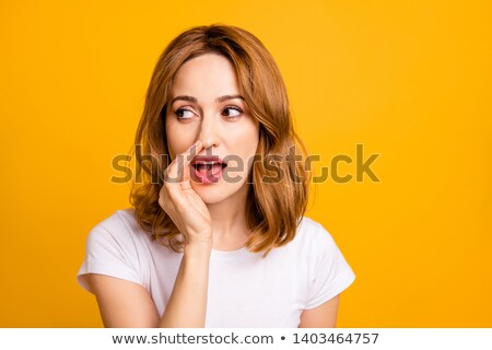 beautiful happy young woman whispering excited stock photo © rosipro